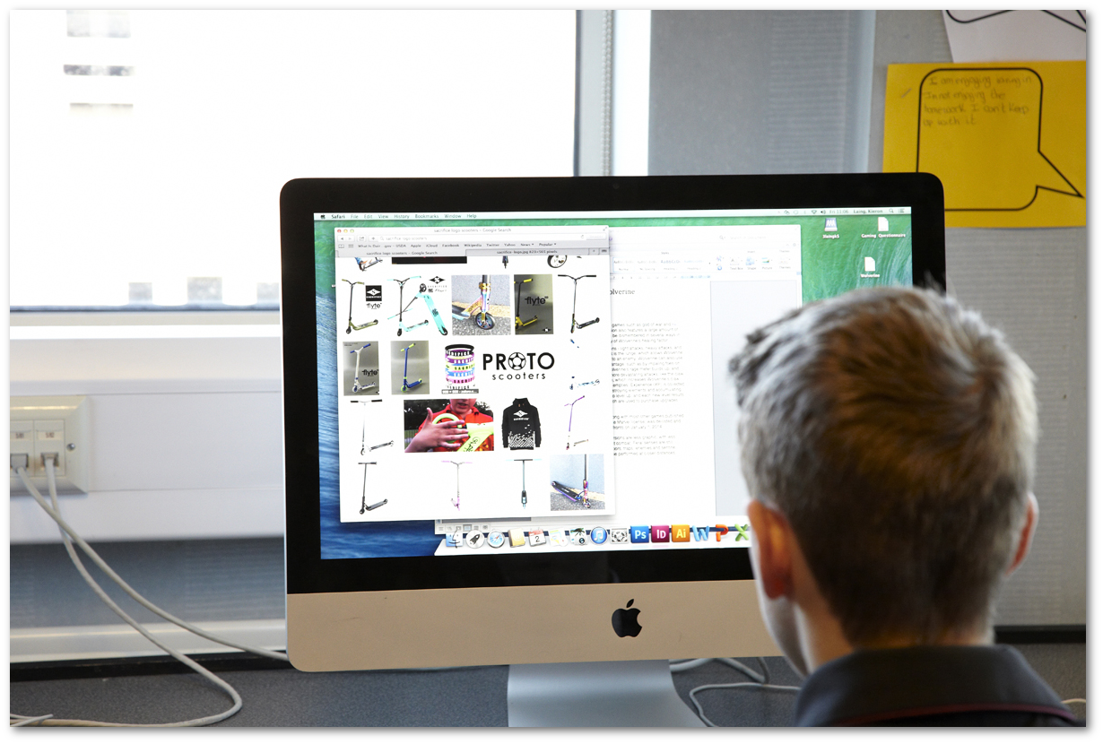 An image of a student sitting in front of a computer screen